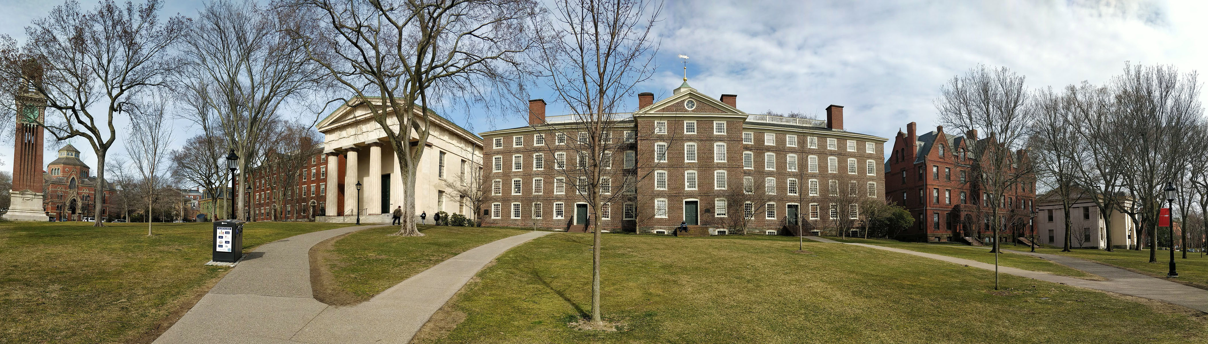 A panoramic view of the central Brown University campus from the east. From left to right are Carrie Tower (1904), Hope College (1822), Manning Hall (1834), University Hall (1770), Slater Hall (1879), and Rhode Island Hall (1840).