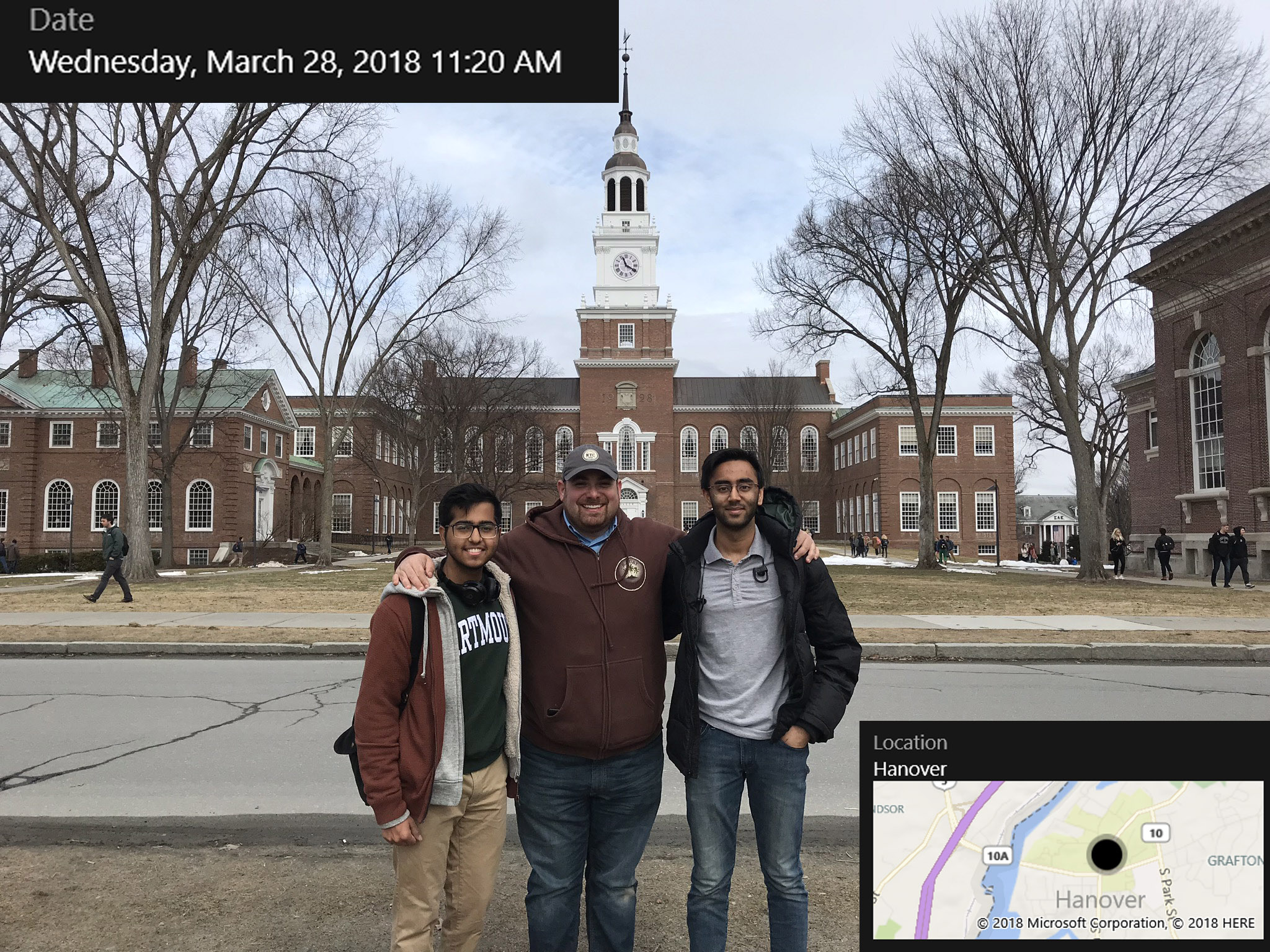 Ben Stern meets with students Sunbir Chawla and Namit Kapoor on the Dartmouth Green outside Baker Library