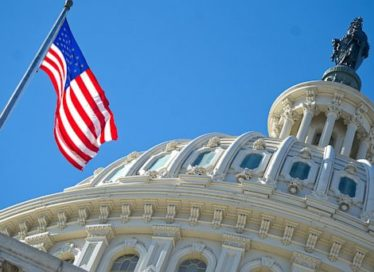 United States Capitol Building with flag